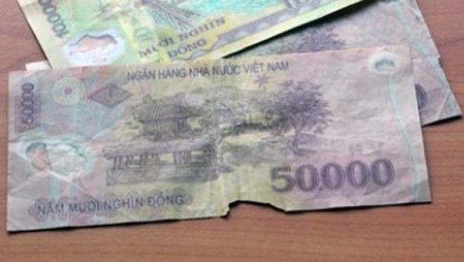 Có được đổi tiền nát, cũ lấy tiền mới? - Luật Trung Kiên